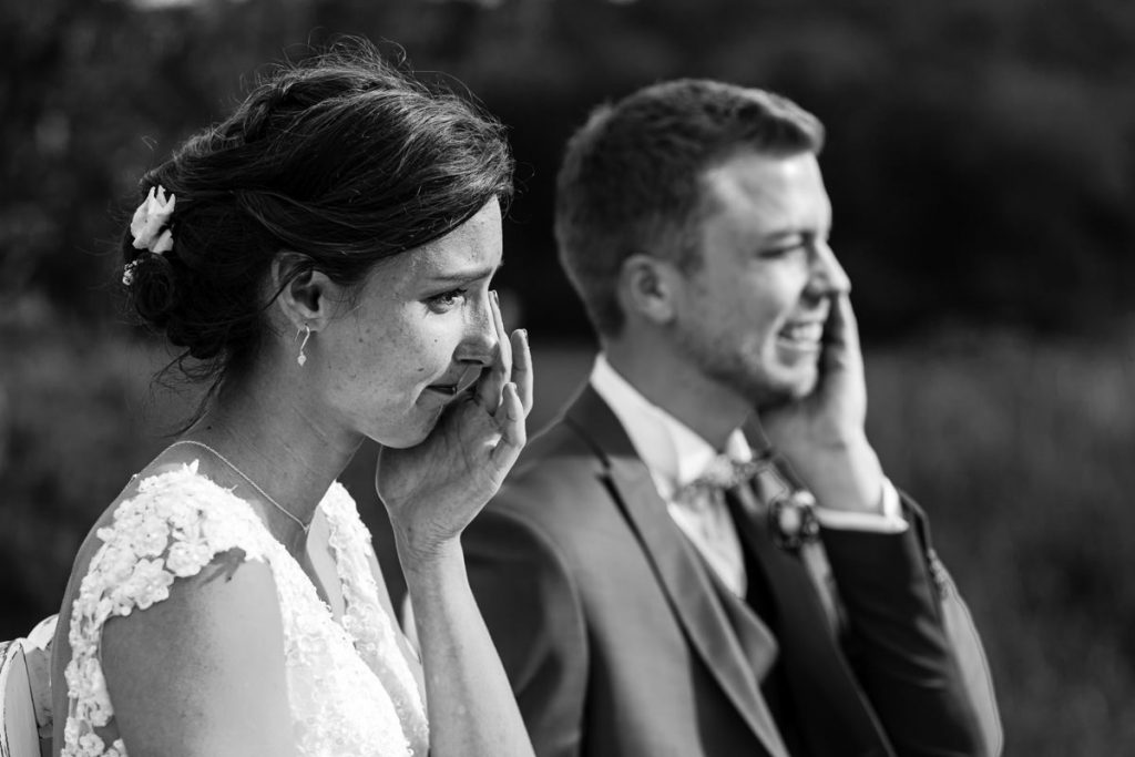 bride and groom laughing and crying at the same time